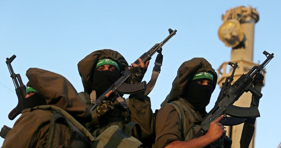 QB holds military parade on Hamas's founding anniversary