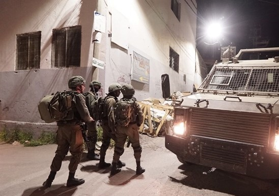 Israeli forces measure home of slain Palestinian in preparation for demolition